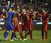 MELBOURNE, AUSTRALIA - JULY 18:  Players from AS Roma celebrate after defeating Real Madrid in a penalty shootout during the International Champions Cup friendly match between Real Madrid and AS Roma at the Melbourne Cricket Ground on July 18, 2015 in Melbourne, Australia.